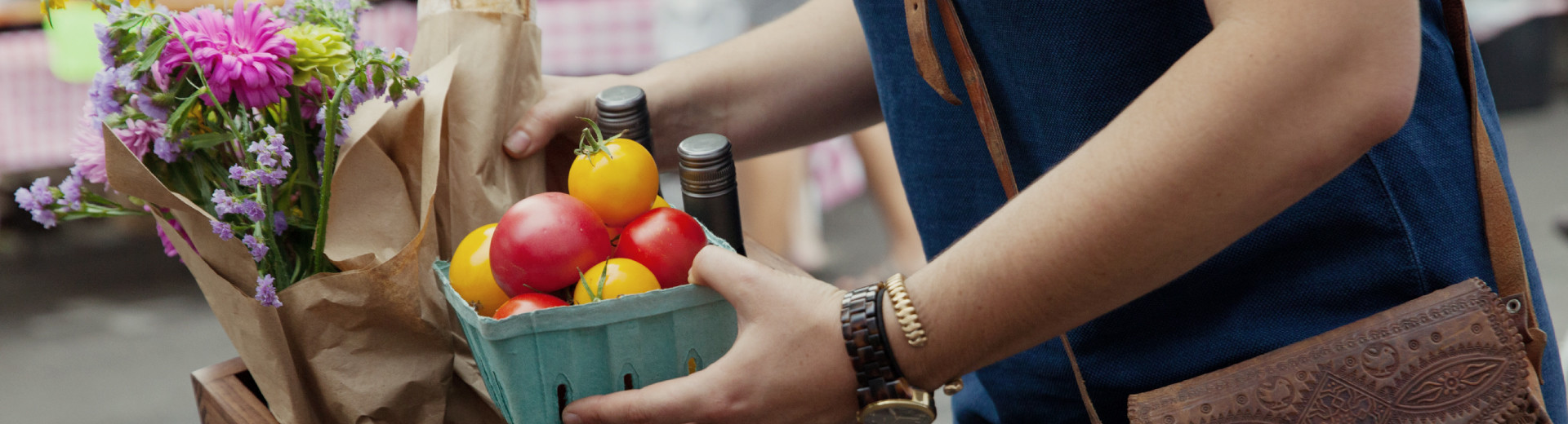 An Atticus Hotel guest enjoys the bounty of the seasonal Farmer's Market located in Historic Downtown McMinnville