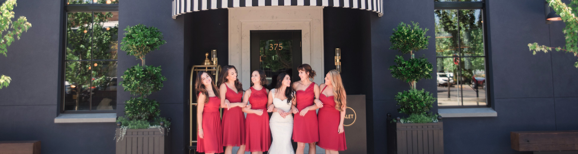 The bride and her bridemaids in front of Atticus Hotel in McMinnville, Oregon