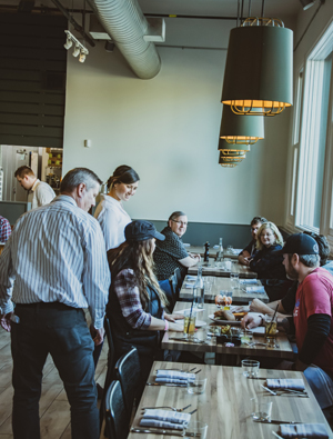 Diners enjoy the food and ambiance at Red Hills Kitchen inside the Atticus Hotel in McMinnville.Photo provided